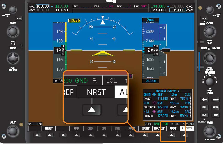 "Figure 11-9. The default soft key menu that is displayed on the PFD contains a ""NRST"" (Nearest Airport) soft key. Pressing this soft key opens a text box which displays the nearest 25 airports."